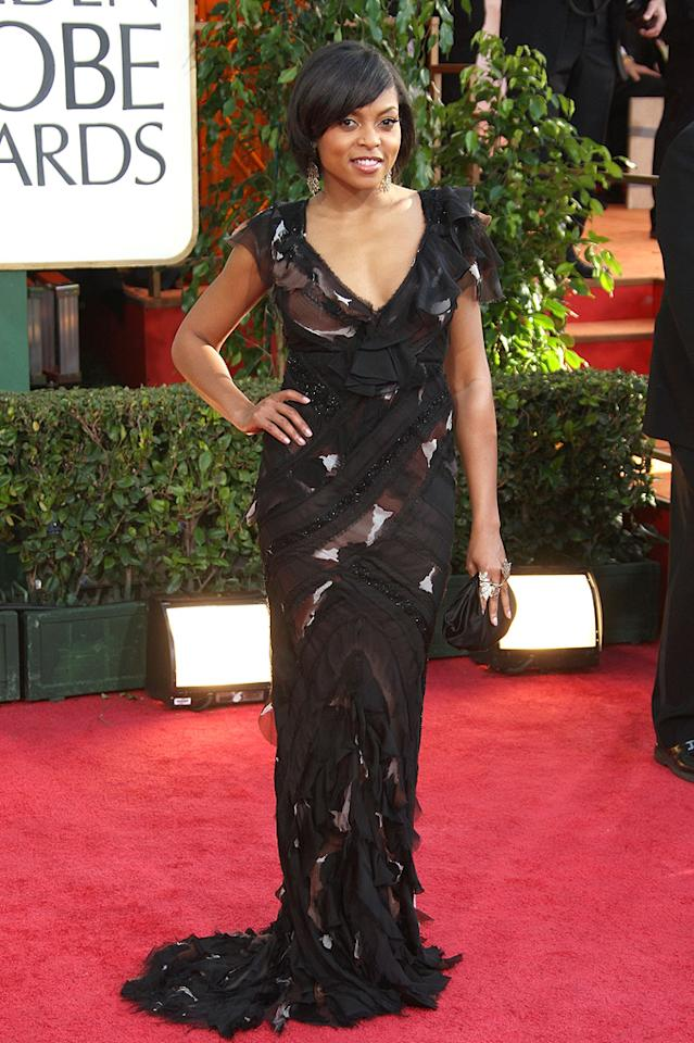 Golden Globe Awards  Grade: C    Though the silhouette is flattering, the muddled combination of print, sequins and ruffles of this J Mendel dress just leaves you confused.