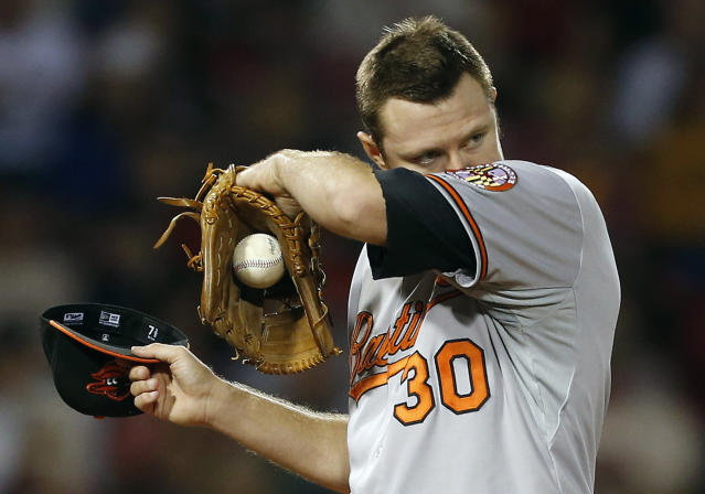 Baltimore Orioles' Chris Tillman wipes his face after giving up a two-run home run to Boston Red Sox's Stephen Drew in the second inning of a baseball game in Boston, Thursday, Sept. 19, 2013. (AP Photo/Michael Dwyer)