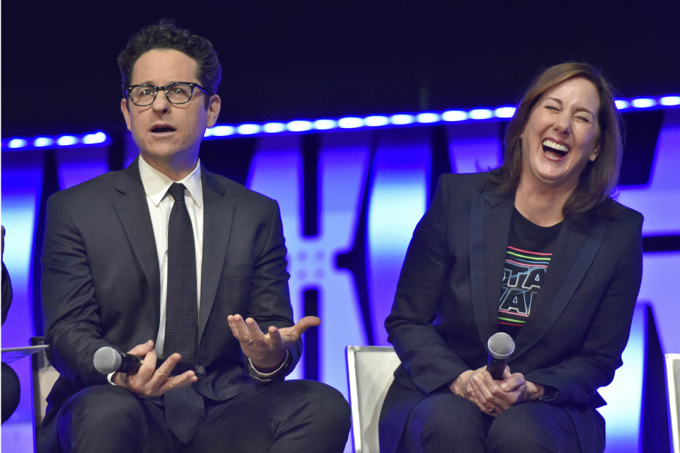 """J.J. Abrams, left, and Kathleen Kennedy participate during the """"Star Wars: The Rise Of Skywalker"""" panel on day 1 of the Star Wars Celebration at Wintrust Arena on Friday, April 12, 2019, in Chicago. (Photo by Rob Grabowski/Invision/AP)"""