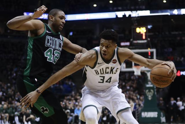 "<a class=""link rapid-noclick-resp"" href=""/nba/teams/mil"" data-ylk=""slk:Milwaukee Bucks"">Milwaukee Bucks</a>' <a class=""link rapid-noclick-resp"" href=""/nba/players/5185/"" data-ylk=""slk:Giannis Antetokounmpo"">Giannis Antetokounmpo</a> tries to drive past <a class=""link rapid-noclick-resp"" href=""/nba/teams/bos"" data-ylk=""slk:Boston Celtics"">Boston Celtics</a>' <a class=""link rapid-noclick-resp"" href=""/nba/players/4245/"" data-ylk=""slk:Al Horford"">Al Horford</a> during the first half of Game 4 in Milwaukee. (AP Photo/Morry Gash)"