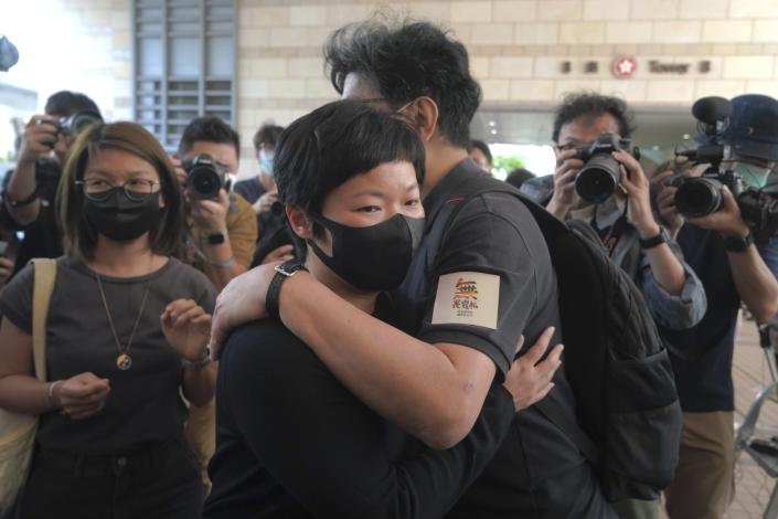 Hong Kong journalist Choy Yuk-ling, also known as Bao Choy, center left, hugs her supporter on her arrival at a court in Hong Kong Thursday, April 22, 2021. Choy appeared in court on Thursday for verdict on charges of making false statements while obtaining information from a vehicle database. Choy, a producer at public broadcaster Radio Television Hong Kong, was arrested in Nov 2020. She was involved in the production of an investigative documentary into the behavior of Hong Kong police during 2019 anti-government protests, after the force was accused of not intervening during a violent clash between protesters and a mob of men in a subway station. (AP Photo/Kin Cheung)
