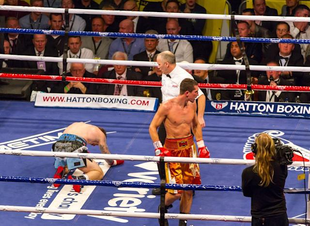 Ricky Hatton on his knees nine rounds later (photo: Neill Hamersley)