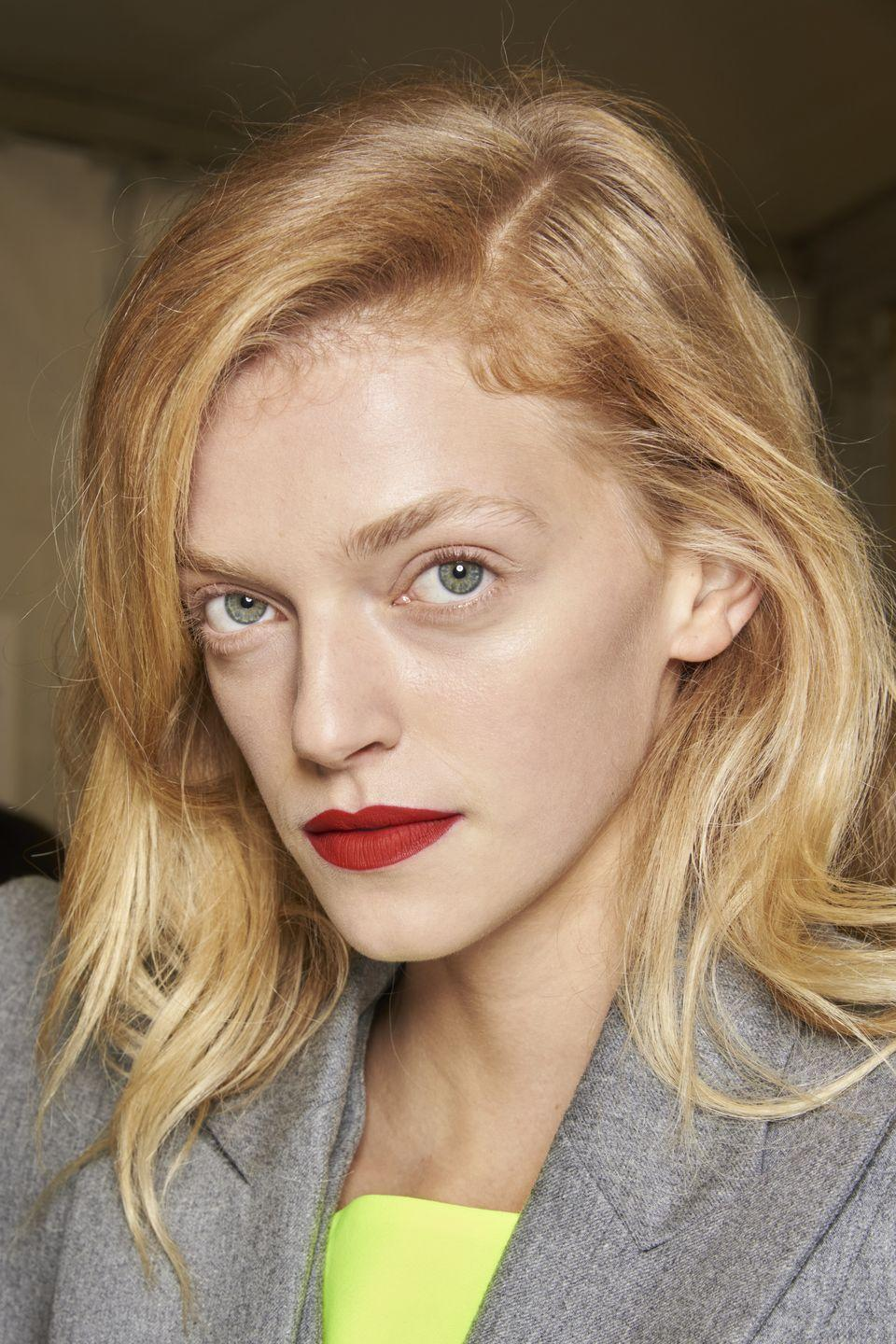 <p>Give classic red lipstick an ultra modern update with a velvet finish and bare lashes and skin a la Balmain.</p>