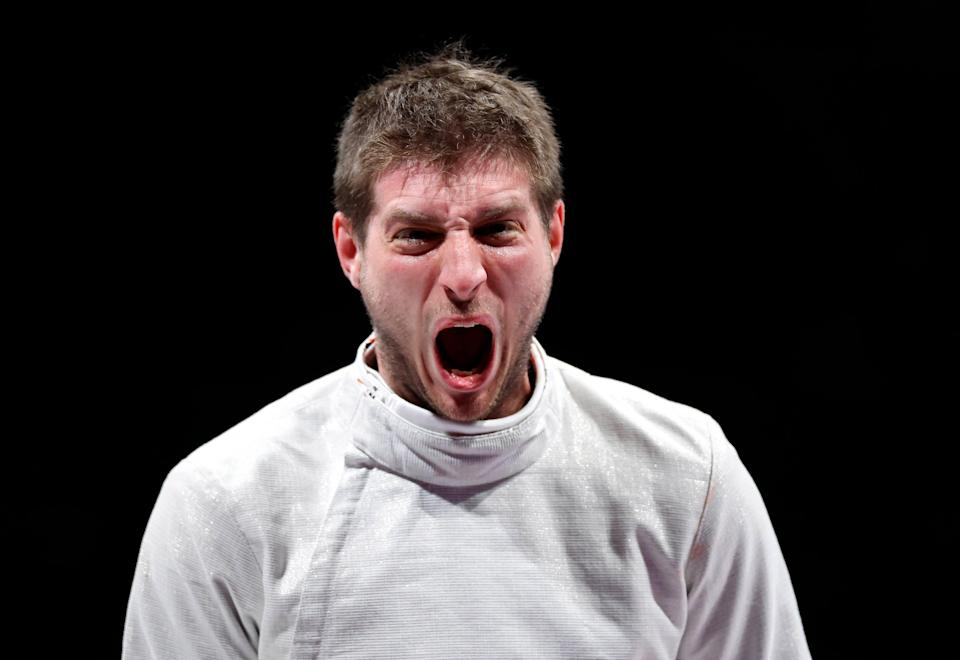 Eli Dershwitz (USA) reacts as he competes against Kaito Streets (JPN) in the men's sabre individual table of 32.