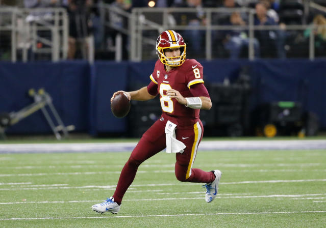 Washington Redskins quarterback Kirk Cousins (8) rolls out of the pocket to pass during an NFL football game against the Dallas Cowboys on Thursday, Nov. 30, 2017, in Arlington, Texas. (AP)