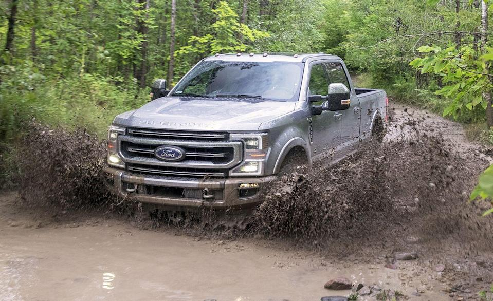"<p>The <a href=""https://www.caranddriver.com/ford/super-duty"" rel=""nofollow noopener"" target=""_blank"" data-ylk=""slk:Ford F-series Super Duty"" class=""link rapid-noclick-resp"">Ford F-series Super Duty</a> is typically spotted towing, but off-road trails don't discriminate. Beyond the usual four-wheel-drive system, the FX4 Off-Road package adds underbody protection and specially tuned shocks. The skid plates cover the two-speed transfer case and fuel tank, while all-terrain tires, hill-descent control, and a rear electronic-locking differential manage speed traction off the beaten path. For 2020 a Tremor off-road packaged was added with a lifted suspension enabling 10.8 inches of ground clearance. To that the Tremor package adds skid plates and 35-inch all-terrain tires. Nicknamed Godzilla, the all-new pushrod V-8 is an enormous 430 horsepower 7.3-liter with 475 lb-ft of torque with a 10-speed automatic transmission. For towing, the 7.3-liter can muster 15,000 pounds off its bumper and up to 20,200 with a gooseneck hitch. While well short of the massive 37,000-pound maximum a diesel F-450 can lug, the diesel is a $10,495 upcharge. The 7.3 is a relatively reasonable $1705 premium.</p>"