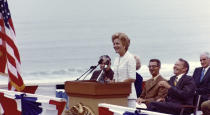 "Then-first lady Pat Nixon speaks at the dedication of Frriendship Park in San Diego, on the border with Tijuana, Mexico, on Aug. 18, 1971. In the days before Joe Biden became president, construction crews worked quickly to finish Donald Trump's wall at an iconic cross-border park overlooking the Pacific Ocean that then-first lady Pat Nixon inaugurated in 1971 as symbol of international friendship. Biden on Wednesday, Jan. 20, 2021 ordered a ""pause"" on all wall construction within a week, one of 17 executive edicts issued on his first day in office, including six dealing with immigration. (Richard Nixon Presidential Library and Museum via AP)"