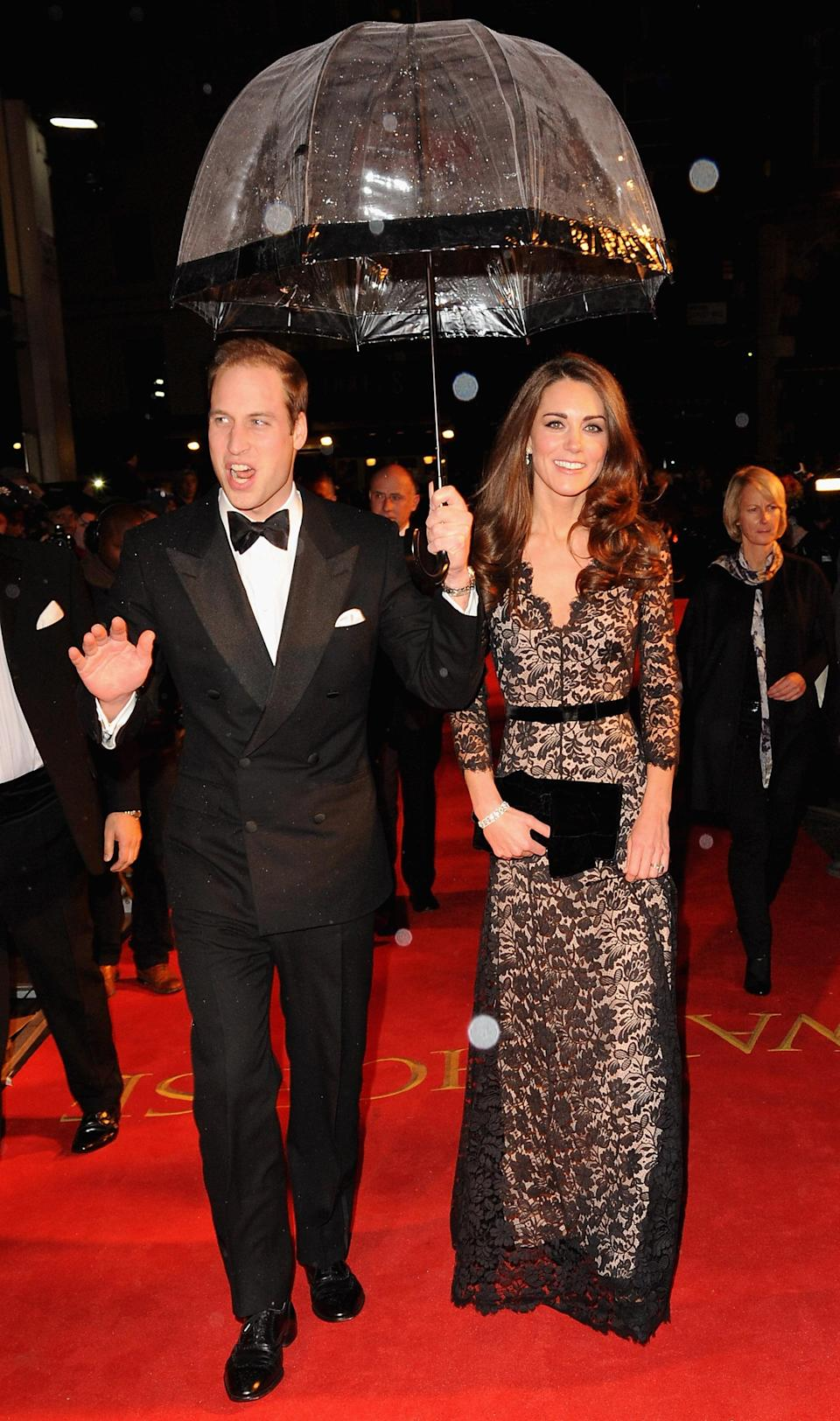 <p>This time, the Duchess of Cambridge kept it simple in a £2,900 Temperley London dress to match Prince William's monochrome tux. <em>[Photo: Getty]</em> </p>