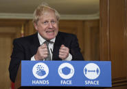 FILE - In this Saturday, Oct. 31, 2020 file photo Britain's Prime Minister Boris Johnson gestures as he speaks during a press conference in 10 Downing Street, London where he is expected to announce new restrictions to help combat a coronavirus surge. (AP Photo/Alberto Pezzali, Pool, File)