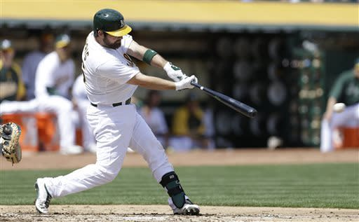 Oakland Athletics' Derek Norris hits an RBI single off Detroit Tigers pitcher Justin Verlander in the second inning of a baseball game Saturday, April 13, 2013, in Oakland, Calif. (AP Photo/Ben Margot)