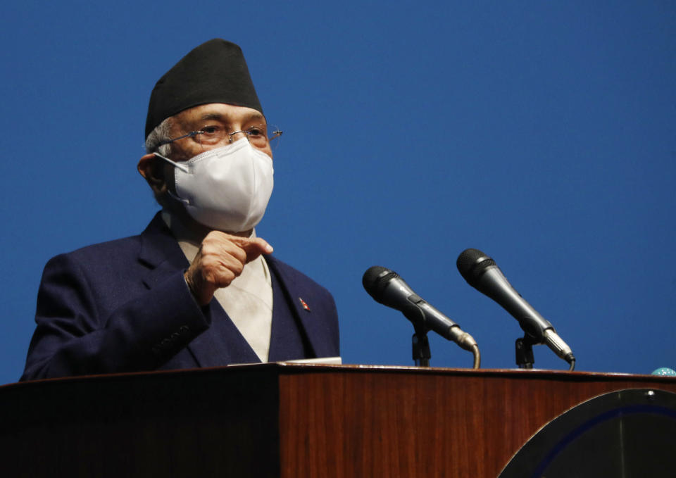 Nepal Prime Minister Khadga Prasad Oli speaks at the parliament in Kathmandu, Nepal, Monday, May 10, 2021. Oli asked parliament for a vote of confidence on Monday in an attempt to show he still has enough support to stay in power despite an expected second split within his governing party. (AP Photo/Niranjan Shrestha)