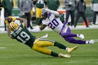 Green Bay Packers' Equanimeous St. Brown can't catch a pass with Minnesota Vikings' Jeff Gladney defending during the second half of an NFL football game Sunday, Nov. 1, 2020, in Green Bay, Wis. (AP Photo/Morry Gash)