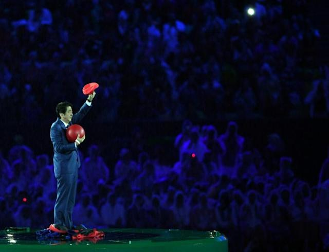 Japan's Prime Minister Shinzo Abe donned a Super Mario outfit to appear at the closing ceremony of the Rio Games (AFP Photo/Ed JONES)
