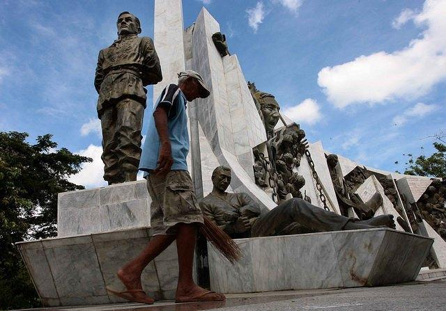 Park caretaker Demetrio Abayon, 73-years old, cleans a bronze statue of national hero Andres Bonifacio in Bundok Nagpatong in Maragondon, Cavite province, located 60-kilometers south of Manila. Amid the nationwide celebration of the country's 113th Independence Day, the Gat Andres Bonifacio mural and eco-park in Maragondon was silent and did not hold any visitors. Bonifacio, founder of the Katipunan and led Filipinos to revolt against Spanish colonizers, was tried with his brother Procopio by a court-martial in a house in Maragondon. Bonifacio and Procopio, was shot to death on May 10, 1897, on Mt. Nagpatong. (Mike Alquinto/NPPA Images)