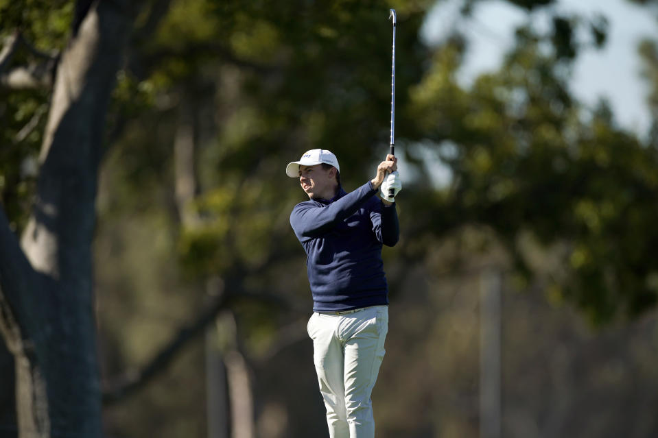 Matthew Fitzpatrick, of England, hits his second shot on the first hole during the third round of the Genesis Invitational golf tournament at Riviera Country Club, Saturday, Feb. 20, 2021, in the Pacific Palisades area of Los Angeles. (AP Photo/Ryan Kang)