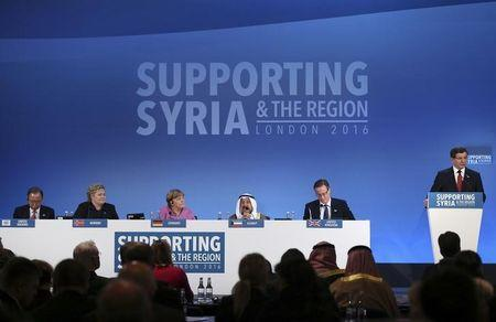 United Nations Secretary-General Ban Ki-moon, Norway's Prime Minister Erna Solberg, German Chancellor Angela Merkel, the Emir of Kuwait, Sheikh Sabah al-Ahmad al-Sabah and Britain's Prime Minister David Cameron (L-R) listen as Turkish Prime Minister Ahmet Davutoglu speaks at the donors Conference for Syria in London, Britain February 4, 2016. REUTERS/Dan Kitwood/pool