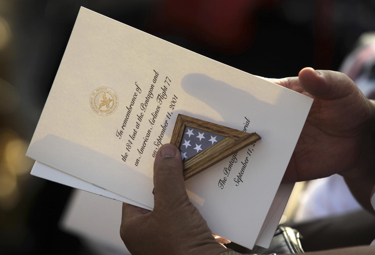 A guest holds the program for ceremonies in honor of the victims of the attack on the Pentagon during ceremonies marking the 10th anniversary of the 9/11 attacks on the Pentagon, in Washington September 11, 2011.  (REUTERS/Molly Riley)