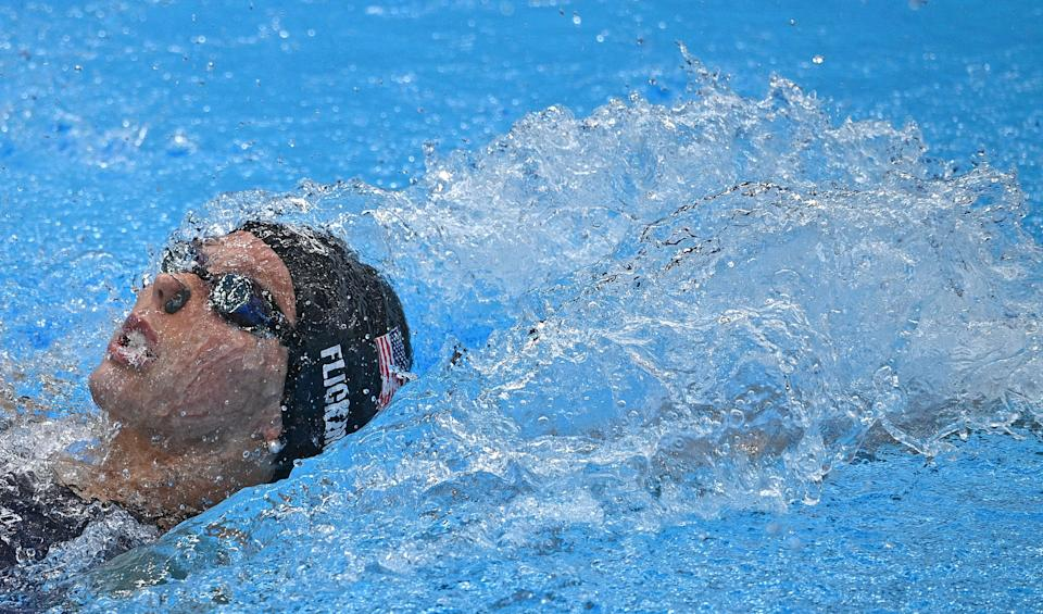 <p>USA's Hali Flickinger competes in the final of the women's 400m individual medley swimming event during the Tokyo 2020 Olympic Games at the Tokyo Aquatics Centre in Tokyo on July 25, 2021. (Photo by Oli SCARFF / AFP)</p>