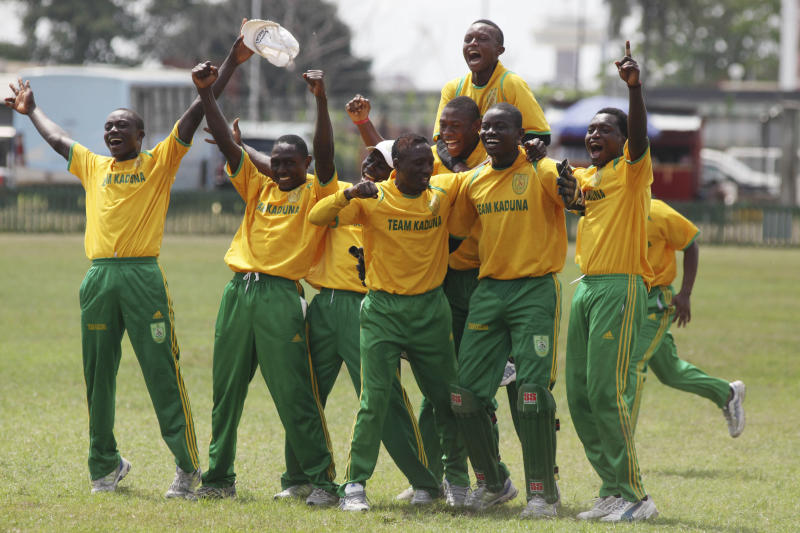 In this photo taken Wednesday, Nov. 28, 2012. Kaduna state, cricket team celebrates after dismissing Rivers state cricket bats man of a wicket during the 18th National sports festival in Lagos, Nigeria. Near the parade ground that Queen Elizabeth II once toured when this nation still was under British rule, the sharp crack of a ball against a bat marks the rebirth of a colonial sport now finding a second life. Cricket, once the preserve of Nigeria's educated elite, is finding favor in schools for poor children and in the streets of some of the nation's most violence-torn cities. Yet cricket has a long history in the country. British colonialists introduced the game to boarders in Nigeria's top secondary schools in the 19th century. Nigeria played its first recorded international game in 1904 against present-day Ghana, local cricket officials say. (AP Photo/Sunday Alamba)