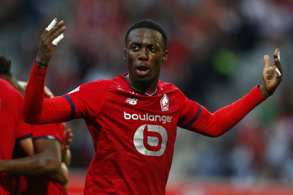 Lille's Timothy Weah celebrates after Lille's Jonathan David scored his side's opening goal during the French League One soccer match between Lille and Reims at the Stade Pierre Mauroy stadium in Villeneuve-d'Ascq, France, Wednesday, Sept. 22, 2021. (AP Photo/Michel Spingler)
