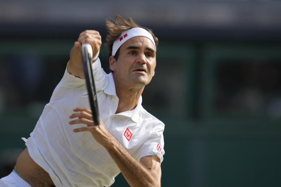 Switzerland's Roger Federer plays a return to Poland's Hubert Hurkacz during the men's singles quarterfinals match on day nine of the Wimbledon Tennis Championships in London, Wednesday, July 7, 2021. (AP Photo/Kirsty Wigglesworth)