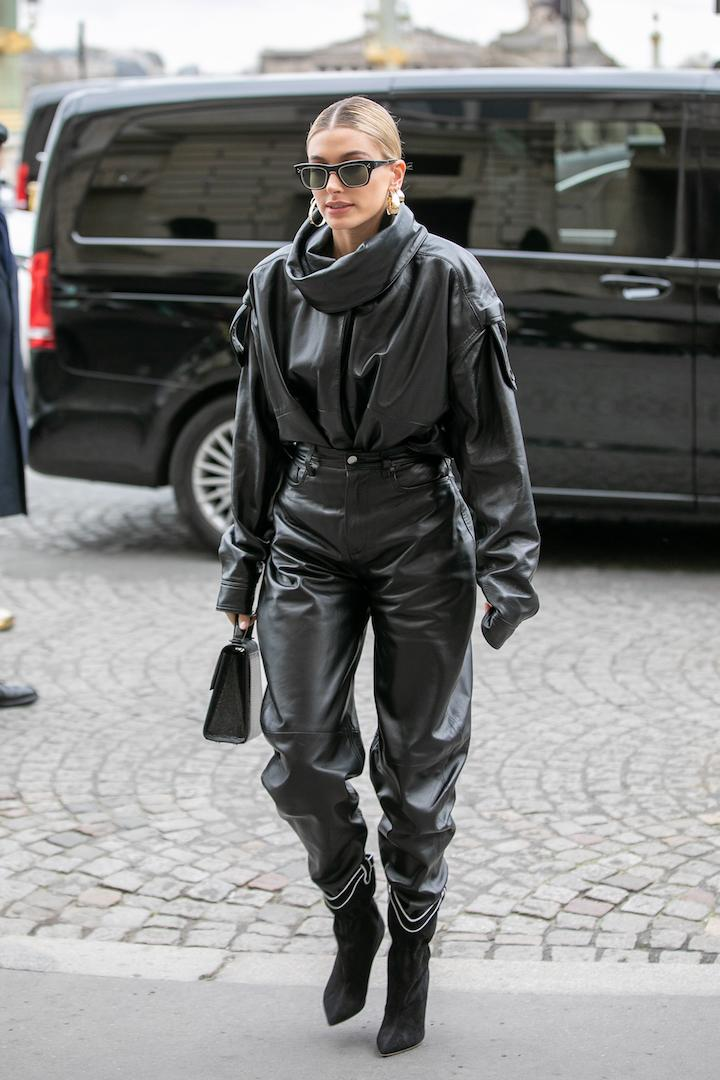 The supermodel made dressing for the spring look effortless after she was spotted out and about in Paris in slouchy black leather. A slick bun and supersized gold hoops finished the pap-ready ensemble. <em>[Photo: Getty]</em>