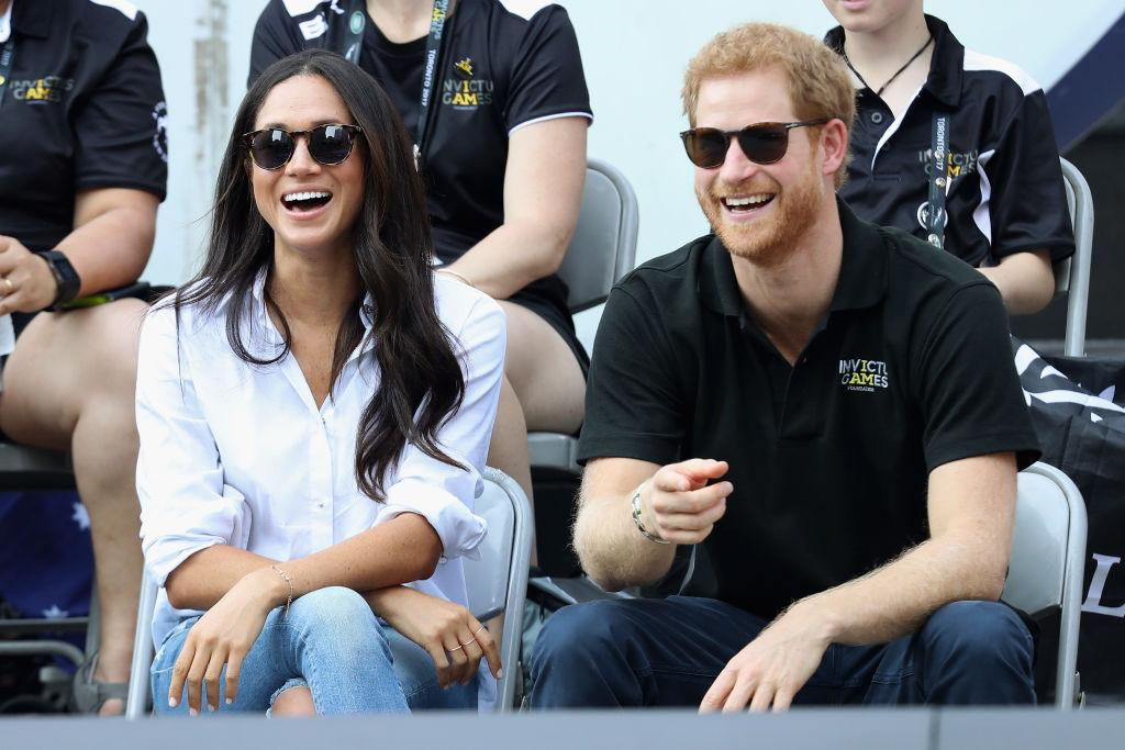 """<p><strong>When: Sept. 25, 2017</strong><br />While taking in a wheelchair tennis match with Harry, the actress wore a $230 CAD ($185 US) <a rel=""""nofollow"""" href=""""https://mishanonoo.com/collections/the-easy-8"""">white shirt by designer Misha Nonoo</a>. Dubbed """"The Husband Shirt,"""" it has sparked more than a few engagement rumours! <em> (Photo: Getty) </em> </p>"""