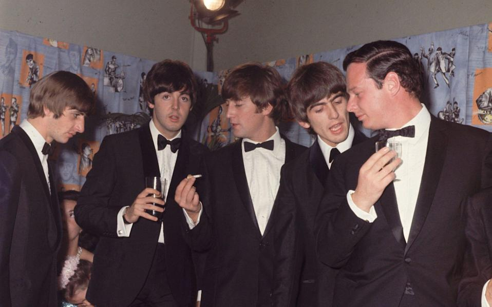 The Beatles with Brian Epstein, right - Hulton Archive/Getty Images