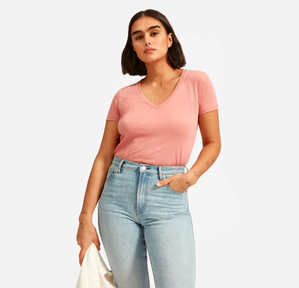 """Everlane makes some of <a href=""""https://www.glamour.com/story/everlane-perform-leggings-review?mbid=synd_yahoo_rss"""" rel=""""nofollow noopener"""" target=""""_blank"""" data-ylk=""""slk:our favorite basics"""" class=""""link rapid-noclick-resp"""">our favorite basics</a> in the game. This V-neck is made of undeniably soft Supima cotton, and apart from the peach color, it also exists in a handful of other neutrals. $18, Everlane. <a href=""""https://www.everlane.com/products/womens-v-white?collection=womens-tees"""" rel=""""nofollow noopener"""" target=""""_blank"""" data-ylk=""""slk:Get it now!"""" class=""""link rapid-noclick-resp"""">Get it now!</a>"""