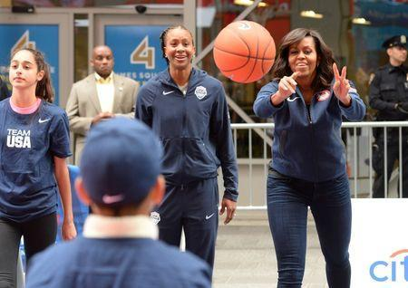 Apr 27, 2016; New York, NY, USA; First Lady Michelle Obama participates in a basketball demonstration during the U.S. Olympic Committee 100 day countdown event to the Rio 2016 Games at Times Square. Mandatory Credit: Robert Deutsch-USA TODAY Sports