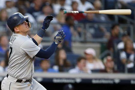 Jun 19, 2018; Bronx, NY, USA; Seattle Mariners first baseman Ryon Healy (27) throws his bat as he flies out against the New York Yankees during the fifth inning at Yankee Stadium. Mandatory Credit: Adam Hunger-USA TODAY Sports