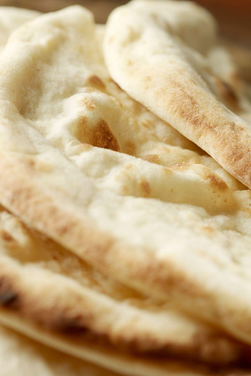 """<p>We absolutely love naan bread. They're perfect for mopping up all of that gorgeous <a href=""""https://www.delish.com/uk/cooking/recipes/a28867202/chicken-bhuna/"""" rel=""""nofollow noopener"""" target=""""_blank"""" data-ylk=""""slk:curry"""" class=""""link rapid-noclick-resp"""">curry</a> sauce, and they're so versatile. Have them plain, topped with black onion seed, or you can stuff them with everything from cheese to coconut. </p><p>Get the <a href=""""https://www.delish.com/uk/cooking/recipes/a29455921/naan-bread/"""" rel=""""nofollow noopener"""" target=""""_blank"""" data-ylk=""""slk:Naan Bread"""" class=""""link rapid-noclick-resp"""">Naan Bread</a> recipe.</p>"""