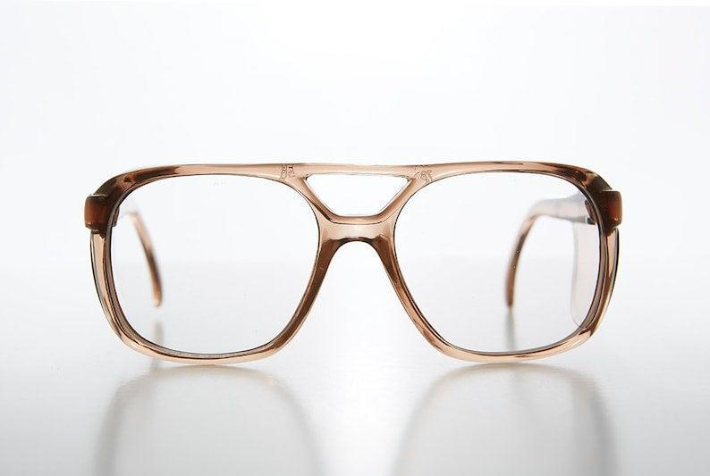 """You'll need some protective eyewear, but they don't have to be like the raggedy pair you wore in GCSE Chemistry. This pair snugly protects you from hazards with a square aviator style.<br><br><strong>SunglassMuseum</strong> Square Aviator Safety Eyeglasses with Protective Side Shields - Warrior, $, available at <a href=""""https://www.etsy.com/uk/listing/890401667/square-aviator-safety-eyeglasses-with"""" rel=""""nofollow noopener"""" target=""""_blank"""" data-ylk=""""slk:Etsy"""" class=""""link rapid-noclick-resp"""">Etsy</a>"""