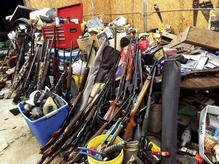 Stacks of guns are seen in a garage belonging to Brent Nicholson in Pageland, South Carolina, in this undated handout picture provided by the Chesterfield County (SC) Sheriff's Office. Inside Brent Nicholson's house, guns were everywhere: rifles and shotguns piled in the living room, halls and bedrooms; handguns littering tables and countertops. Outside, when sheriff's investigators rolled up the door on the pre-fab metal garage, more arms spilled out at their feet. The question of how one man amassed such a stockpile of guns arises just as there is renewed American soul-searching over the widespread availability of firearms in the wake of a series of mass shootings. REUTERS/Chesterfield County (SC) Sheriff's Office/Handout via Reuters