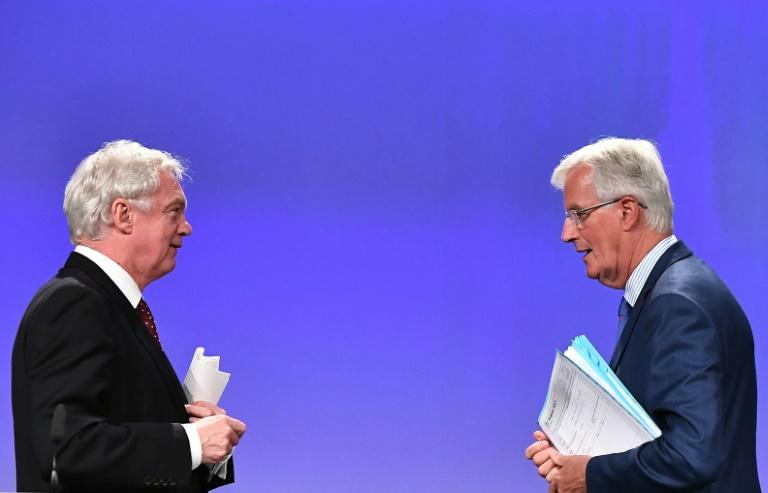 British Secretary of State for Brexit David Davis (L) and EU chief Brexit negotiator Michel Barnier meet again for talks after Barnier said the previous round of discussions had produced no major breakthroughs