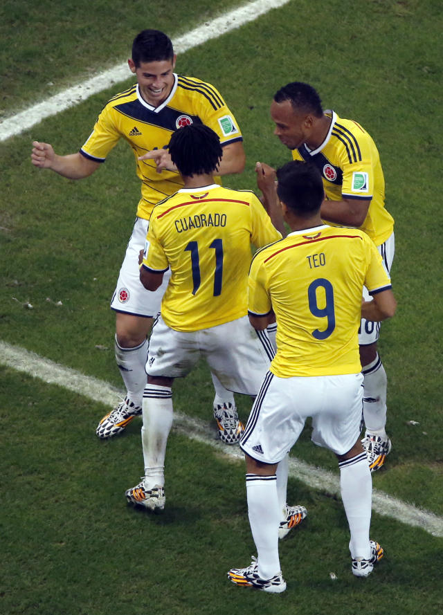 FILE - In this June 28, 2014, file photo, file photo, Colombia's James Rodriguez, left, dances as he celebrates with his teammates after scoring his side's second goal during the World Cup round of 16 soccer match between Colombia and Uruguay at the Maracana Stadium in Rio de Janeiro, Brazil. The euphoria in soccer-mad Colombia is deafening, and wonderfully contagious, ahead of Friday's do-or-die World Cup match against host Brazil. Not since Colombia drubbed Argentina 5-0 in a 1993 World Cup qualifier has the South American nation of 48 million been so enthralled by the beautiful game. (AP Photo/Fabrizio Bensch, Pool, File)