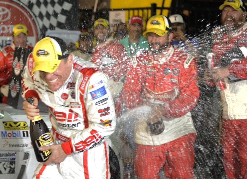 Kevin Harvick is doused with champagne by his crew in Victory Lane after winning the Toyota Owner's 400 NASCAR Sprint Cup series auto race at Richmond International Raceway in Richmond, Va., Saturday April 27, 2013. (AP Photo/Clem Britt)