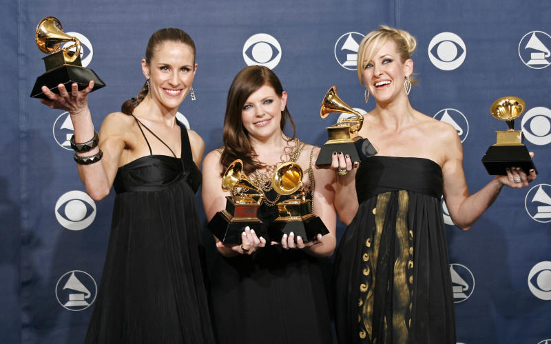 "The Dixie Chicks (L-R) Emily Robison, Natalie Maines and Martie Maguire pose with their Grammys at the 49th Annual Grammy Awards in Los Angeles February 11, 2007. The group won the Record of The Year, Song of the Year and Best Country Performance by a Duo or Group with Vocal for ""Not Ready to Make Nice""; and Best Country Album and Album of the Year for ""Taking The Long Way"". REUTERS/Mike Blake (UNITED STATES)"