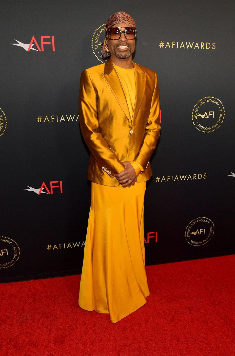 <p>Porter wore shimmering burnt orange-coloured Dolce & Gabbana suit jacket and a golden dress by Calvin Klein to the AFI Awards Luncheon.</p>