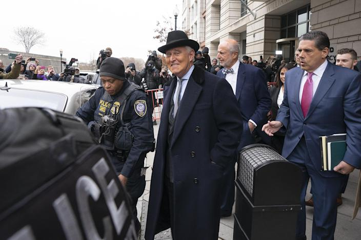 Roger Stone, former adviser to Donald Trump's presidential campaign, center, exits federal court in Washington, Feb. 20, 2020. (Stefani Reynolds/Bloomberg via Getty Images)