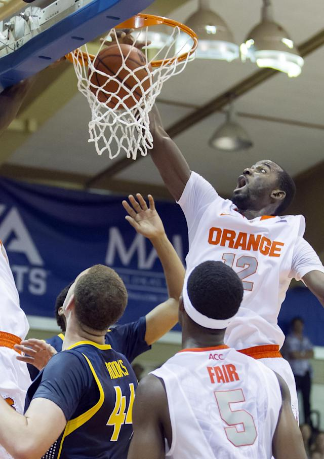 Syracuse center Baye Moussa Keita (12) dunks the ball as California center Kameron Rooks, bottom left, and Syracuse forward C.J. Fair (5) look on during the first half of an NCAA college basketball game at the Maui Invitational on Tuesday, Nov. 26, 2013, in Lahaina, Hawaii. (AP Photo/Eugene Tanner)