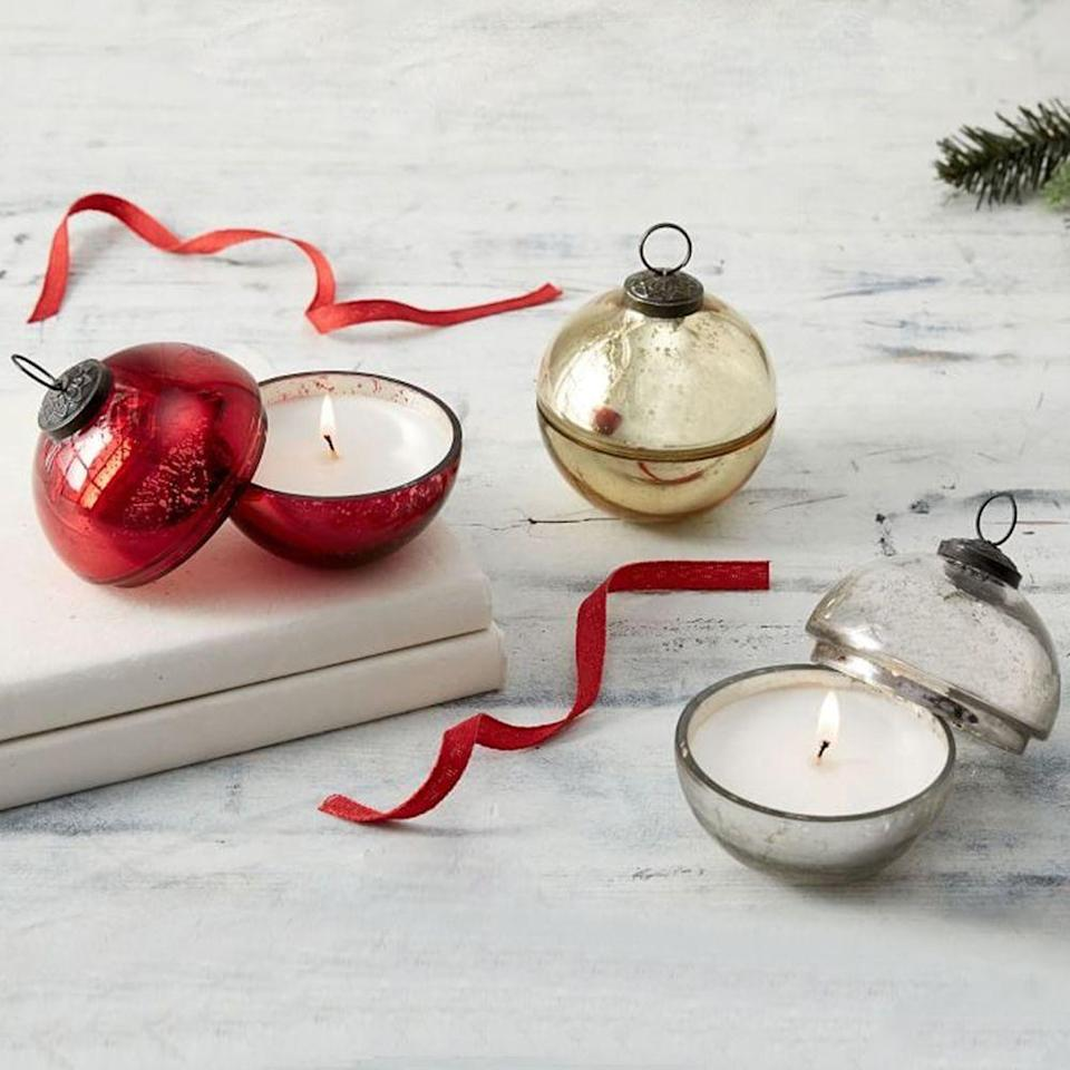 "<p><strong>Pottery Barn</strong></p><p>potterybarn.com</p><p><strong>$49.50</strong></p><p><a href=""https://go.redirectingat.com?id=74968X1596630&url=https%3A%2F%2Fwww.potterybarn.com%2Fproducts%2Fornament-candlepot%2F&sref=https%3A%2F%2Fwww.bestproducts.com%2Fhome%2Fg34618598%2Fcandle-gift-sets%2F"" rel=""nofollow noopener"" target=""_blank"" data-ylk=""slk:Shop Now"" class=""link rapid-noclick-resp"">Shop Now</a></p><p>If you're looking for a serious holiday candle gift set, this is it. These three winter-scented candles come in blown soda lime glass in the shape of ornaments. The Snow Currant fragrance has notes of apple, clove, and thyme. Each small candle has a 15-hour burn time.</p>"
