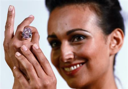 A model displays the 'Pink Star' 59.60 carat oval cut pink diamond at Sotheby's in Geneva September 25, 2013. REUTERS/Ruben Sprich