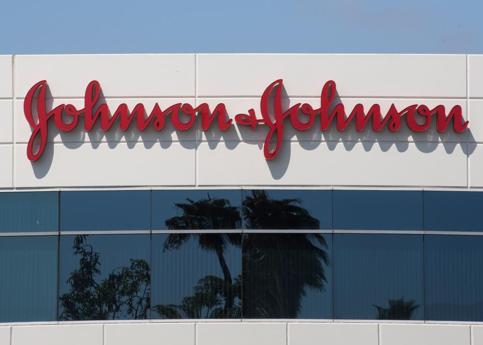 A sign on a building at the Johnson & Johnson campus shows their logo in Irvine, California on August 28, 2019. - The US pharmaceutical industry faces tens of billions of dollars in potential damage payments for fueling the opioid addiction crisis after Oklahoma won a $572 million judgment against drugmaker Johnson & Johnson. (Photo by Mark RALSTON / AFP)        (Photo credit should read MARK RALSTON/AFP/Getty Images)