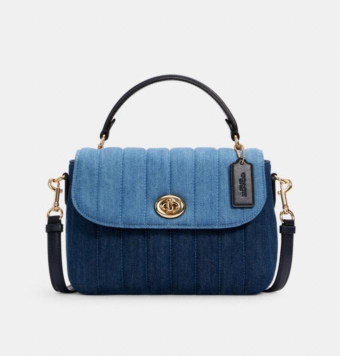 Marlie Top Handle Satchel With Quilting. Image via Coach Outlet.