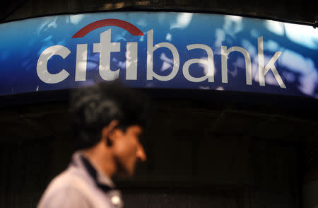 A man walks in front of a Citibank branch in Mumbai