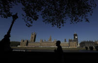 The sun shines above Britain's Houses of Parliament as the country is in lockdown to help curb the spread of coronavirus, in London, Tuesday, April 21, 2020. Britain's Parliament is going back to work, and the political authorities have a message for lawmakers: Stay away. U.K. legislators and most parliamentary staff were sent home in late March as part of a nationwide lockdown to slow the spread of the new coronavirus. With more than 16,500 people dead and criticism growing of the government's response to the pandemic, legislators are returning Tuesday — at least virtually — to grapple with the crisis. (AP Photo/Kirsty Wigglesworth)