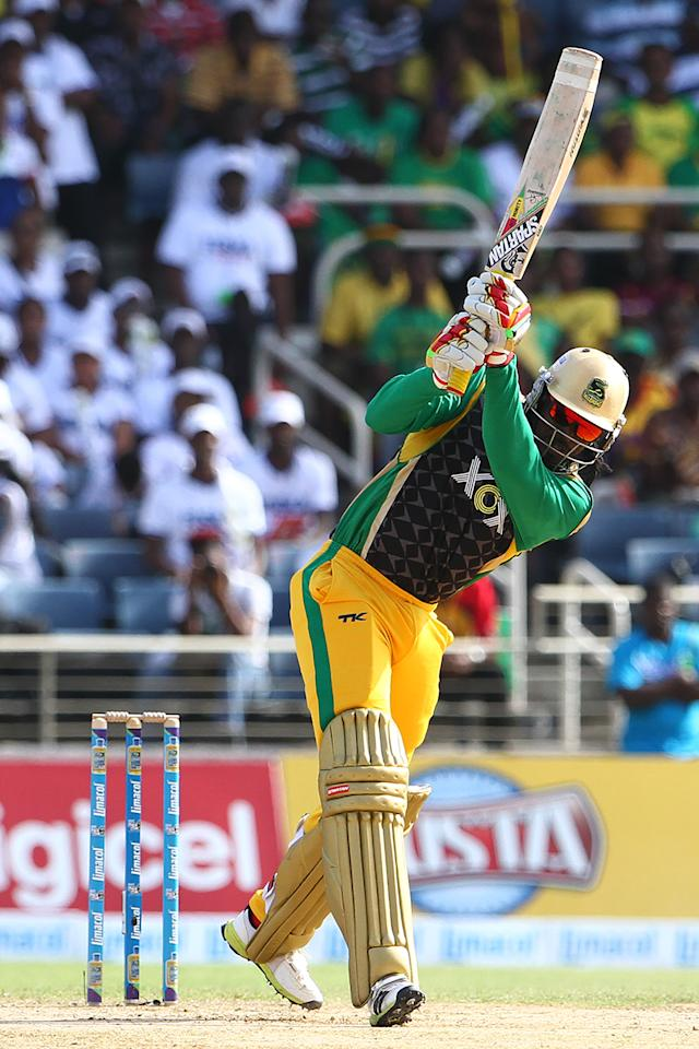KINGSTON, JAMAICA - AUGUST 15: Chris Gayle bats with the shades on during the Sixteenth Match of the Cricket Caribbean Premier League between Jamaica Tallawahs v Guyana Amazon Warriors at Sabina Park on August 15, 2013 in Kingston, Jamaica. (Photo by Ashley Allen/Getty Images Latin America for CPL)