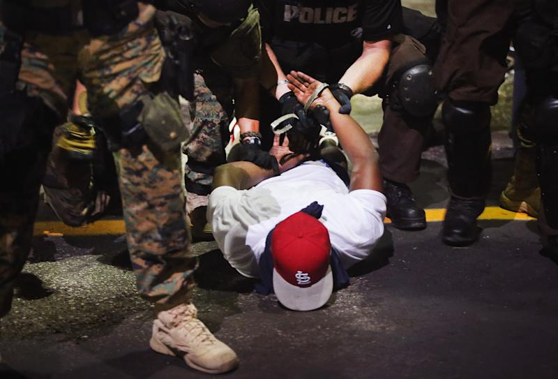 Police arrest a demonstrator in Ferguson on Aug. 19, 2014. (Scott Olson via Getty Images)
