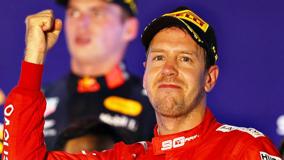 Pictured here, Sebastian Vettel celebrates after the Singapore GP.